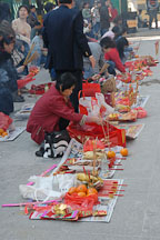 Visitors to the Wong Tai Sin Temple prepare a food offering. Hong Kong, China. - Photo #15688