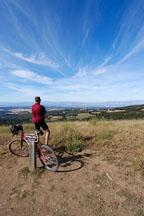 Mountain biker enjoying the view from Borel Hill. Russian Ridge Open Space Preserve. California, USA. - Photo #4317