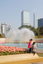 Two girls by the fountain in Hong Kong Park. Hong Kong, China. - Photo #16441