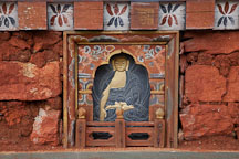 Carved slate panel showing a Buddha on one of the 108 Chortens at Dochu La, Bhutan. - Photo #23118