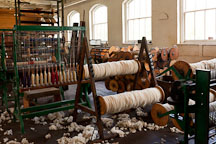 Spools holding wool roving. Thomas Kay Woolen Mill, Salem, Oregon. - Photo #28018
