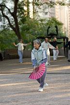 Woman with fan. Kowloon Park, Hong Kong, China. - Photo #14719