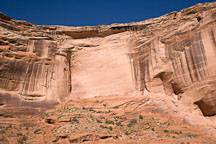 Canyon del Muerto wall with tiny ruin in bottom right. Canyon de Chelly NM, Arizona. - Photo #18145