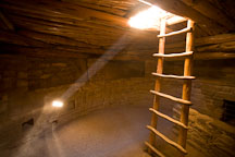 Light shines through the inside of a kiva. Spruce Tree House, Mesa Verde NP, Colorado. - Photo #18620