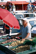 Man selling produce from boats. Kauppatori, Helsinki, Finland. - Photo #445