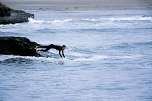Surfer entering water at Natural Bridges State Beach, Calfornia. - Photo #899