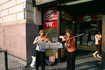 Two women musicians playing violins on Aleksanterinkatu. Helsinki, Finland. - Photo #367