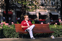 Young man sitting on a bench. Runeberg Esplanadi. Helsinki, Finland. - Photo #385