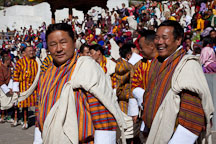Men wearing gho and sash (kabney). Thimphu tsechu, Bhutan. - Photo #22420