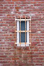 Barred window and brick wall. Santa Cruz Lighthouse, California. - Photo #19525