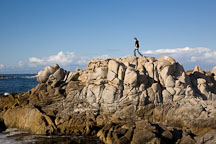 Teenager hiking over coastal rocks. Pacific Grove, California. - Photo #19535