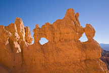 Windows forming in rock fins. Bryce Canyon NP, Utah. - Photo #19063
