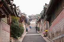 An alley leads pedestrians through Bukchon, a neighborhood in Seoul, South Korea. - Photo #20912