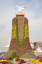 Character Worldee sits atop a flower covered sculpture in Wolmido, Incheon, South Korea. - Photo #20104