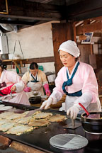 Haemul pajeon (seafood pancake) is made by pouring batter on a griddle, placing seafood and vegetables on top, followed by more batter. Pajeon is a popular food in Korea. - Photo #20529