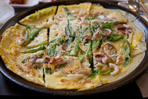 Haemul pajeon (seafood pancake) with green onions is a popular Korean dish. - Photo #20869