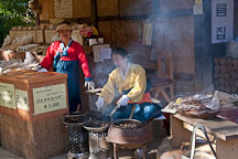 These women are making gun bam, or roast chestnuts at the Korean Folk Village. - Photo #20582