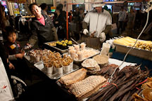 Street vendor with many different kinds of food, including sweet corn and toasted seafood. Myeongdong, Seoul, South Korea. - Photo #20713