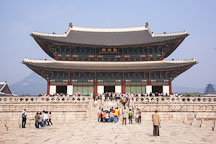 Tourists flock to Geunjeong Hall, which is the throne hall