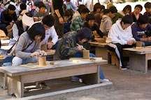 Korean students participate in a traditional pottery making class at the Korean Folk Village in Yong-in City. - Photo #20386