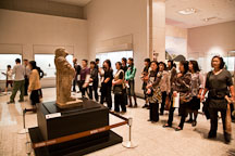 Visitors to the National Museum of Korea gather around a stone zodiacal figurine representing a monkey from the 8th century. - Photo #20177