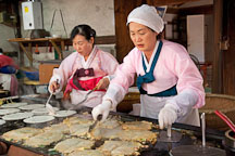These women are preparing haemul pajeon, Korean pancakes filled green onions and seafood. - Photo #20535