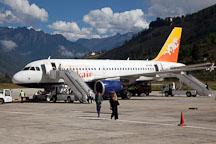 Drukair plane on the runway of the Paro airport. Paro, Bhutan. - Photo #22322