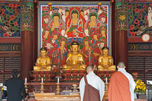 Altar in Daewoongjeon with statues of Sakyamuni Buddha (center) is flanked by Amitabha Buddha and Bhaisagya Buddha. Bongeunsa Temple, Seoul, Korea. - Photo #21865