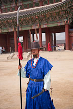 Guard with polearm at Gyeongbok Palace in Seoul, South Korea. - Photo #21090