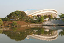 The Olympic Indoor Swimming Pool Building overlooks Lake 88 at Seoul's Olympic Park. - Photo #21676