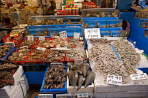 An overflowing stall awaits shoppers at the Noryangjin Fish Market in Seoul. - Photo #21225
