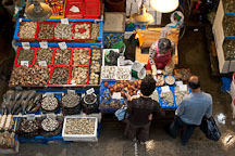 Shoppers peruse the many varieties of seafood available at the Noryangjin Fish Market in Seoul. - Photo #21186