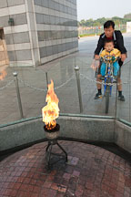 The Torch of Peace, an eternal flame, burns at the base of the World Peace Gate at Olympic Park in Seoul, South Korea. - Photo #21640