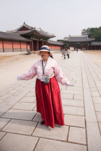 A tour guide speaks to visitors at Changdeok Palace in Seoul, South Korea. - Photo #21472