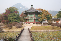 A two-story pavilion overlooks Hyangwonjeong pond at Gyeongbok Palace in Seoul, South Korea. - Photo #21043