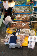 Vendors check the crabs (ge) they are selling in their stall at the Noryangjin Fish Market in Seoul. - Photo #21201