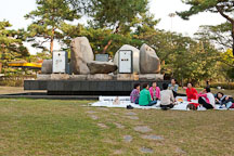 Women enjoy a picnic in front of artist Erik Dietman's sculpture, Yesterday and the Day Before Today and Tomorrow, at Olympic Park in Seoul, South Korea. - Photo #21678