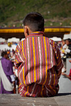 Boy wearing gho. Thimphu tsechu, Bhutan. - Photo #22446