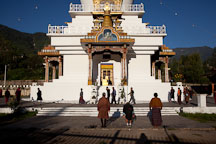 Buddhists praying and walking clockwise at the National Memorial Chorten. Thimphu, Bhutan. - Photo #22867