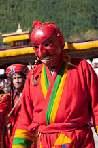 Clown (atsara) wearing bright red mask. Thimphu tsechu, Bhutan. - Photo #22424