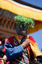 Atsara (clown) collecting donations from the crowd. Thimphu tsechu, Bhutan. - Photo #22605