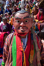 A clown (atsara) moves through the audience to collect donations. Thimphu tsechu, Bhutan. - Photo #22617