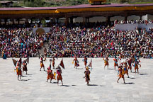 Dancers in the courtyard of the Tashi Chhoe Dzong. Thimphu tsechu, Bhutan. - Photo #22632