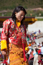 Female dancer dressed in kira. Thimphu tsechu, Bhutan. - Photo #22471