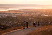 Hikers watching the sunset over the Bay Area. Mission Peak, California. - Photo #22215
