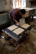 Laying thin sheet of pulp to create paper sheets. Jungshi Handmade Paper Factory, Thimphu, Bhutan. - Photo #22974