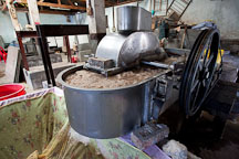 Machine for beating mulberry bark fibers at the  Jungshi Handmade Paper Factory. Thimphu, Bhutan. - Photo #22959
