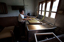 Man using wooden frame and bamboo screen to obtain a thin layer of pulp. Jungshi Handmade Paper Factory, Thimphu, Bhutan. - Photo #22965