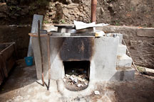 Oven and boiler used to cook fibers. Jungshi handmade paper factory, Thimphu, Bhutan. - Photo #22956
