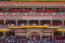 People watching the Thimphu tsechu dances from the Tashi Chhoe Dzong. Thimphu, Bhutan. - Photo #22594